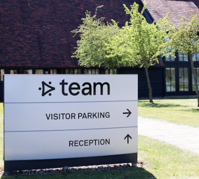 team consulting car park sign
