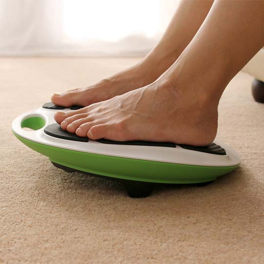 close up of bare feet on revitive device
